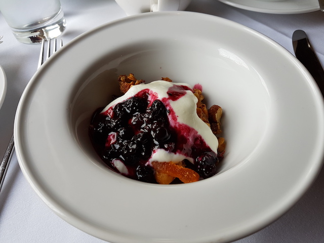 Bowl with homemade granola, fruit compote and yoghurt looking delicious