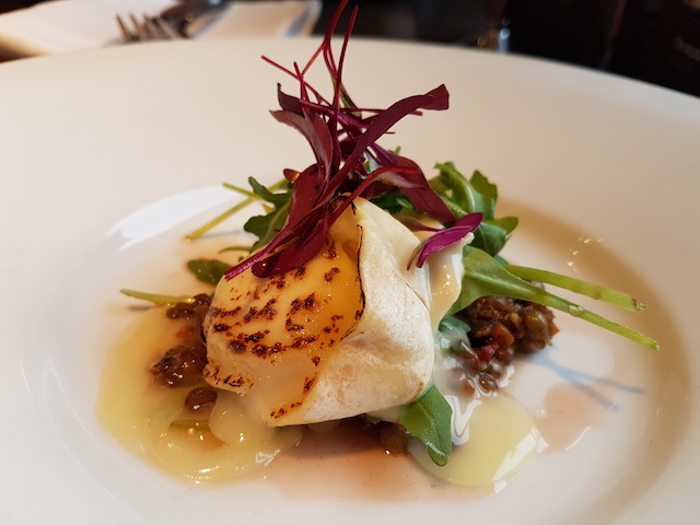 Plate with toasted goats cheese and salad leaves