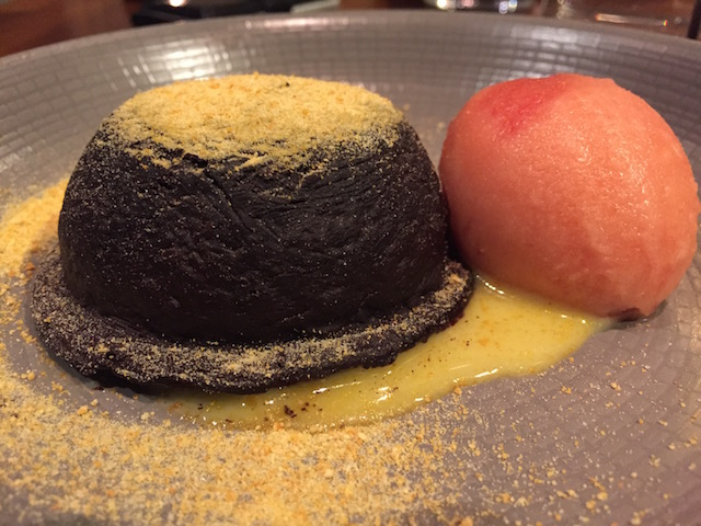 Plate at Taisteal Edinburgh with dessert of Chocolate and Zuzu Fondant with Orange Curd, Powder and Sorbet