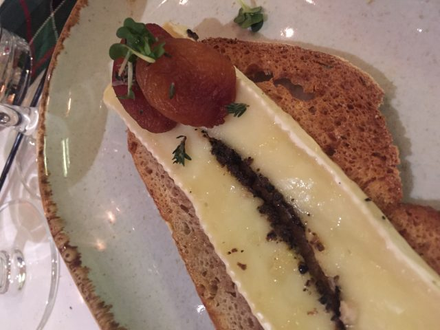 Plate showing Honey and truffled brie on caramelised onion brioche with pickled apricot served with 2015 Clonakilla, Viognier, Canberra District, Australia