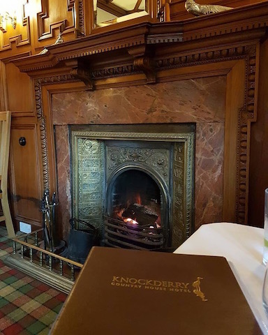 Our tablet in front of the fireside with log fire