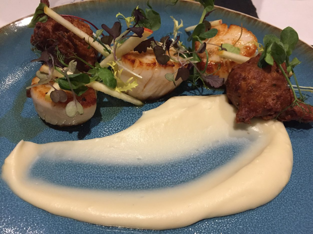 Plate showing Hand Dived Isle of Skye King Scallops with cauliflower pakora, apple caramel