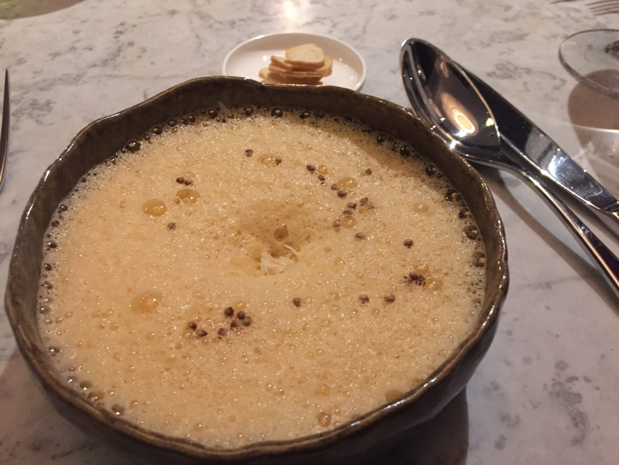 Plate showing Crab and Lemongrass velouté with rouille, and Parmesan